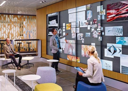 exeutives display collaborative workspace